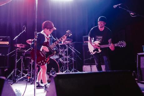 Landsdale resident Jayden Tatsciore (9) on stage with Hells Bells guitarist Mal Osborne.