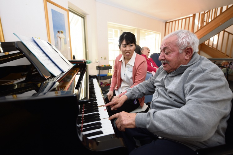 Antonio Capone and his carer Hiromi Tsutsui. Photo: Jon Hewson
