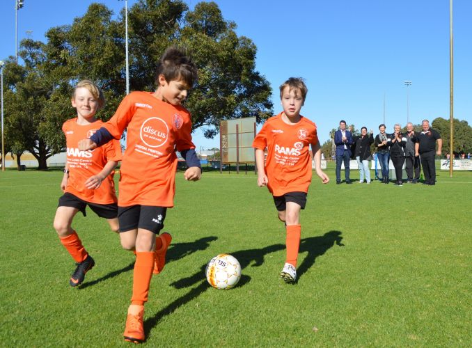 Morley Windmills Soccer Club under-9 players Ben Tanner, Hayden Chomicki and Heath Wilson-Clark with Perth Federal candidate Patrick Gorman, Maylands MLA Lisa Baker, Morley MLA Amber-Jade Sanderson, soccer club president Sharyn Smith, life member Kevin Perrin and sports club president John Castrilli.