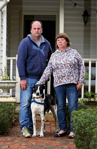 Sue and Mark Cantrell with their dog Henry. Picture: David Baylis www.communitypix.com.au   d483487
