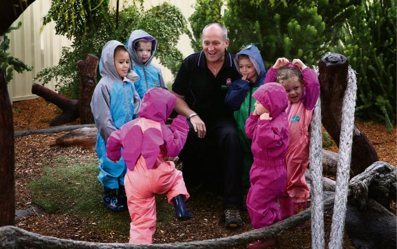 Ken Scott-Hamilton (centre director) with kids. Photo: Martin Kennealey