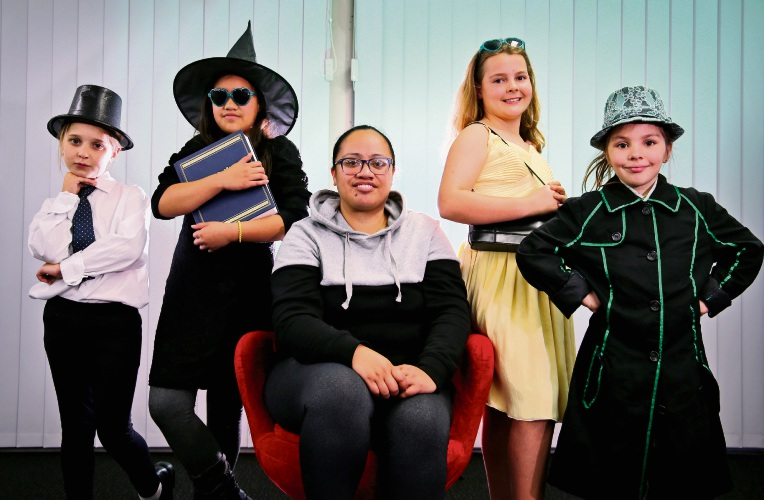 Amelie Sorgiovanni (8) of Lesmurdie as the Wizard, left, Ngahina Dunn (9) of Forrestfield as Elphaba, writer/director Lee Morunga, Abby Letts (11) of Lesmurdie as Glinda and Talia Hintz (10) of Forrestfield as Boq starring in Wicked Jnr. Picture:  David Baylis.