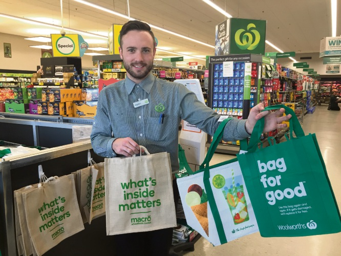 Downtown Mandurah Woolworths employee Jaydon shows off the new bags