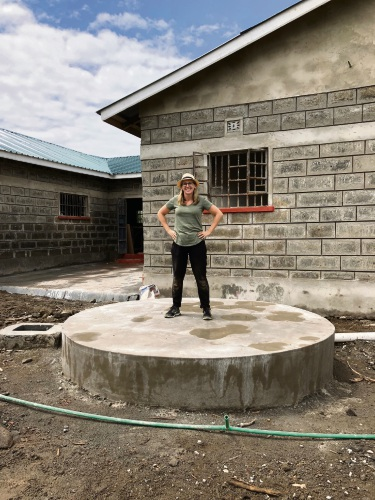 Mercy College teacher Elise Harrison standing where the water tank will be installed.
