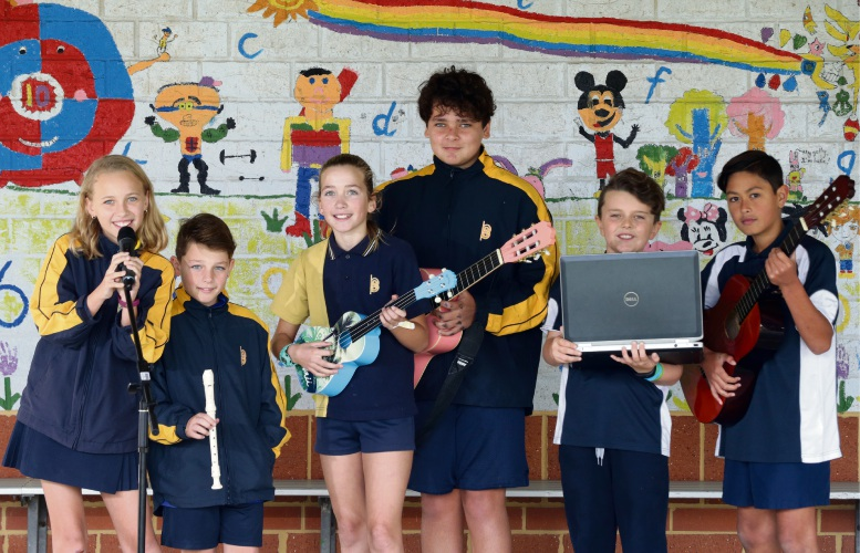 Making music: Butler Primary School students Ava Witt, Oliver Savoury, Sofia Potts, Zane Wesley, Harry Nicholls and Teihana Browne. Pictures: Martin Kennealey www.communitypix.com.au   d484100