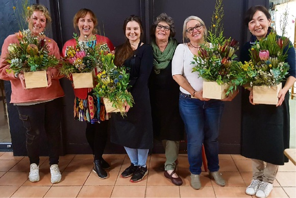Left to right: Leanne Neeson with her daughter Ayesha, Monique Stewart, Maria Hart, Annie Hill and Rika Yamagami with their wildflower displays at Wild Seasons Flowers in Kalamunda. Photo: David Baylis
