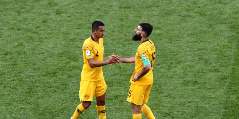 Tim Cahill and Mile Jedinak after the loss to Peru. Photo: Getty.