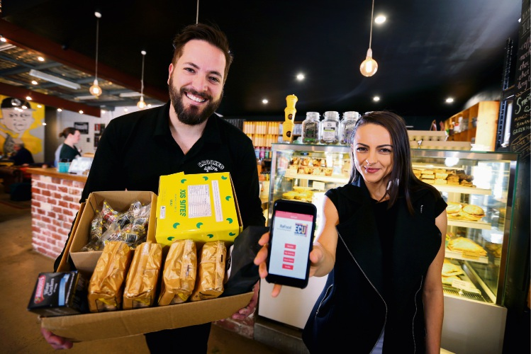 Crooked Spire Coffee House owner Mike Matich, left, and Ele Stojanoska hold the ReFood app outside the Midland caf. Picture: David Baylis.