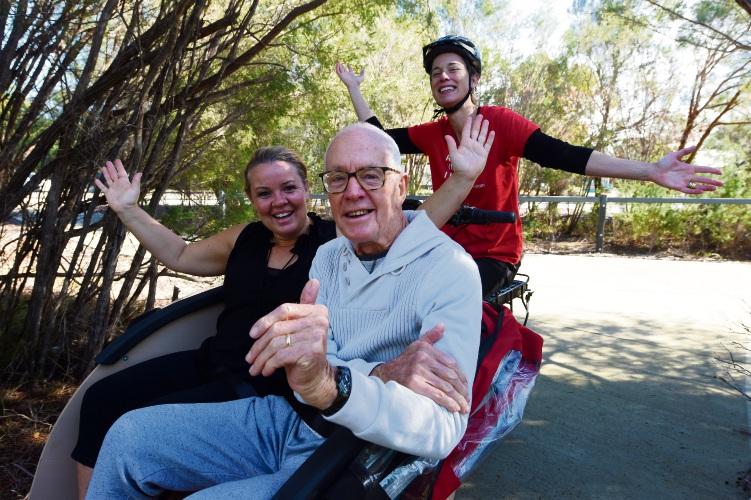 Founder Dorthe Pedersen and Mandurah Affiliate John Wass in the rickshaw ebike piloted by Jennifer Patterson of Cottesloe. Picture: Jon Hewson.