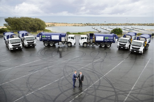 Joondalup Mayor Albert Jacob with SUEZ state general manager Nial Stock and the new City of Joondalup-branded SUEZ trucks at Ocean Reef Boat Harbour.