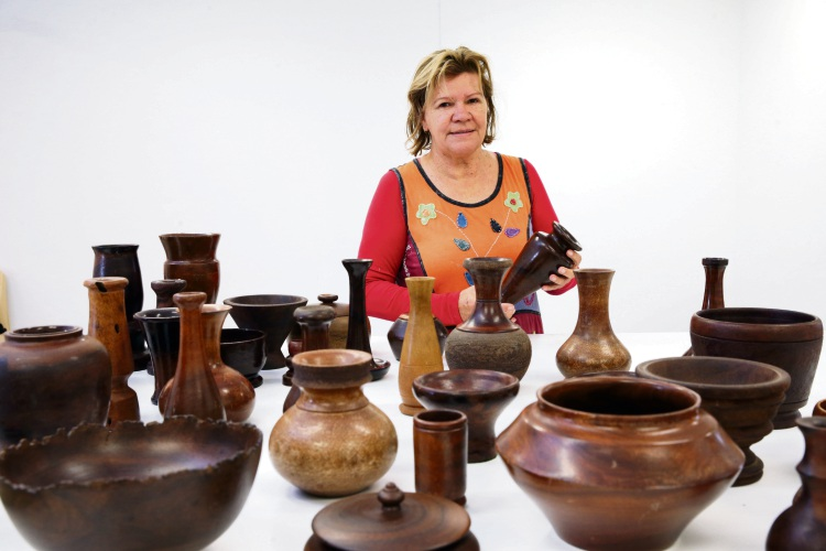 Joondalup Boorungur curator Sharyn Egan with 'The Nullians' turned grass tree objects.