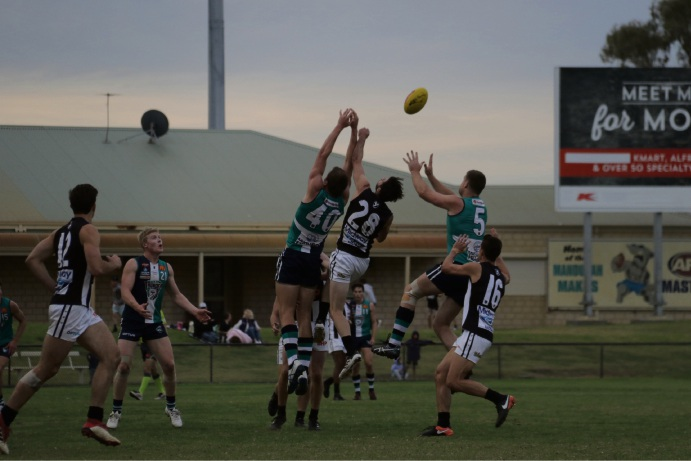 The Thunder and Swans reach for the ball. Sean Allan Photography.