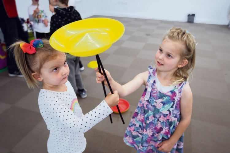 Jasmine Atkinson and Katie Williams practice circus skills at a school holiday workshop in Dayton. Picture: Bruce Hunt  d484528