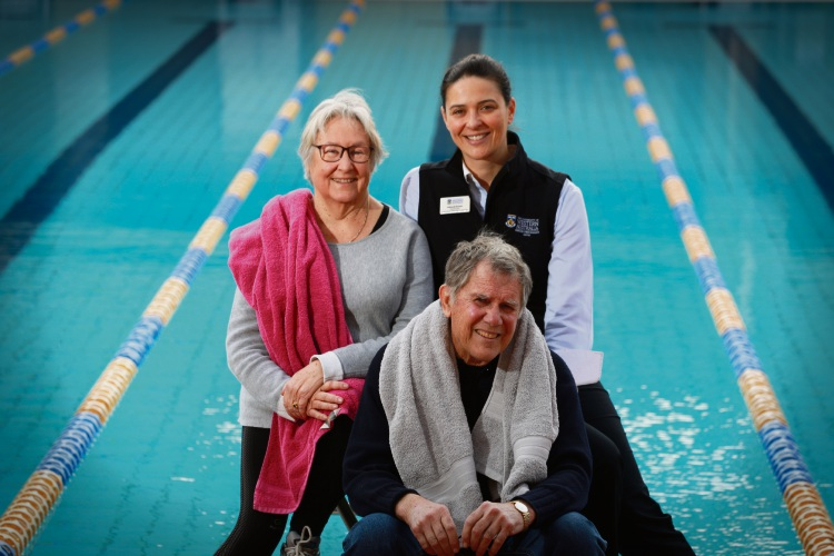 Medi-swim participants (l-r) Kerry and Roger Smith, with physiotherapist Deborah Kounis, at the study's pool at UWA. Picture: Andrew Ritchie.