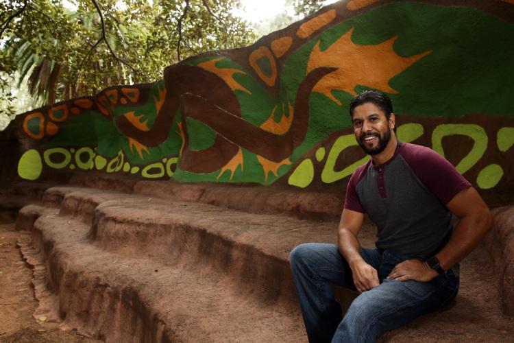 Artist Darryl Bellotti with his mural in progress.