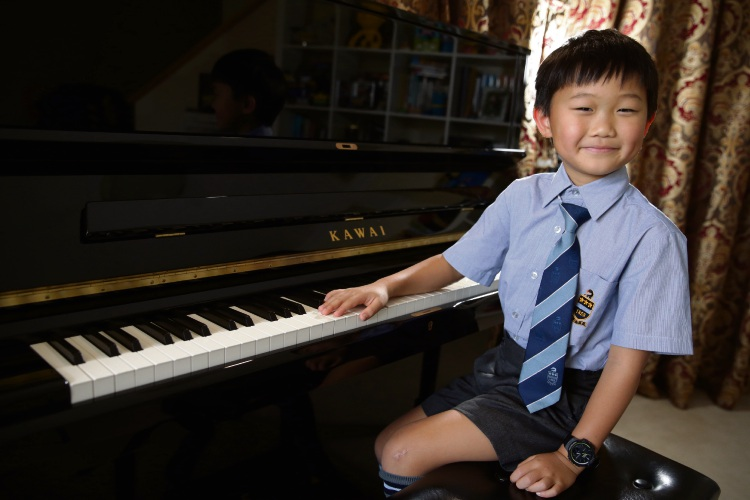 Jinnry Zhuang has had his first international piano performance at just seven-years-old. Picture: Martin Kennealey.