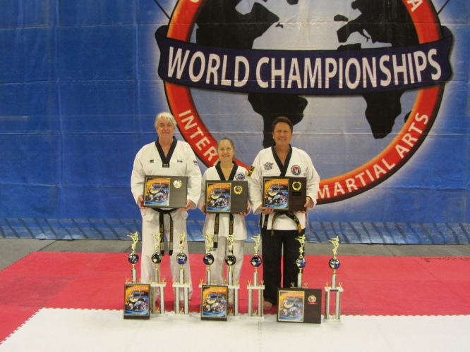 Australian taekwondo competitors Ross Hartnett, Carmela Hartnett and John Gill.