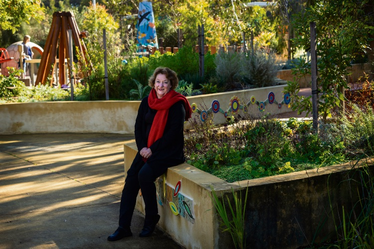 Fremantle artist Jenny Dawson sits among the artwork at the Piney Lakes Sensory Play Park. Picture: Will Russell