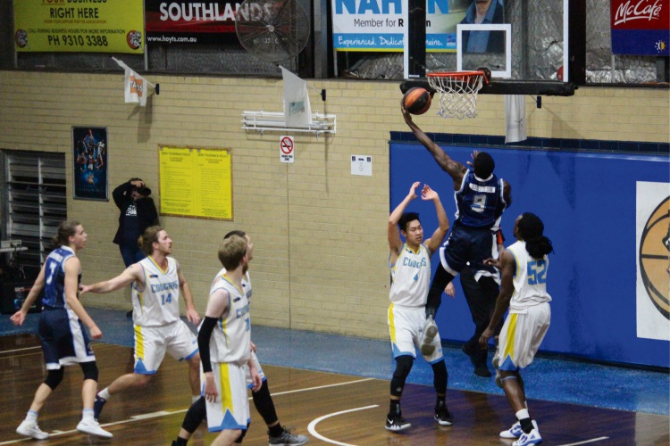 Willetton's Badou Diagne goes to the hoop over Cockburn's Seva Chan and Brandon Sebirumbi.