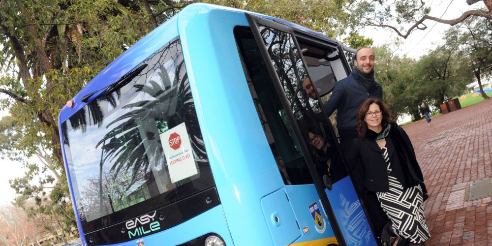 University of WA vice-chancellor Dawn Freshwater and safety operator Arnaud Lago are all aboard the electric shuttle bus being used and tested on the campus from this Sunday.  Picture: Jon Bassett.