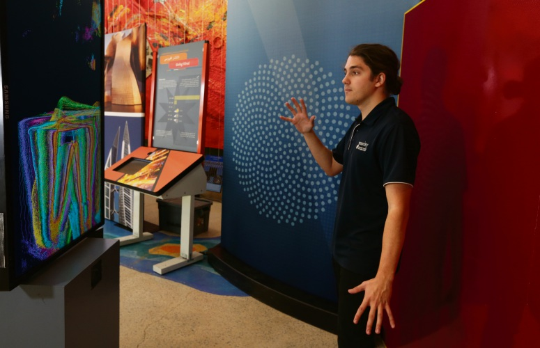 Riley Johnston (tour guide/astronomer) in the Binary Imaging Exhibition.  Photo: Martin Kennealey