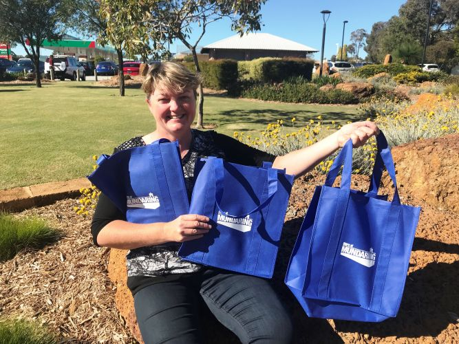 Councillor Toni Burbidge with a handful of the Shire's free re-usable bags outside Mundaring Shire Administration Centre.