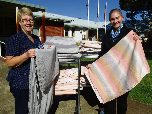 Nurse Mary Storie and Communicare's Victoria Robinson with the donated curtains.