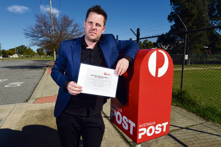 Canning councillor Jesse Jacobs with the Campbell Street post box in East Cannington, which was slated for removal. Picture: Jon Hewson.