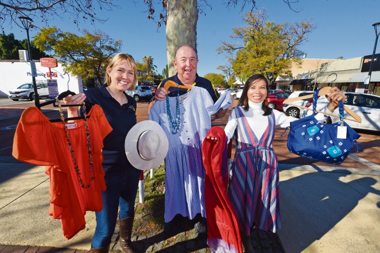 Rotary Jacaranda Festival organising committee member Kate Zappa, Rotary Club of Applecross president Ian Fairnie and Sophie's Silks owner Sophie Cowell with some items likely to be at this year's festival. Picture: Jon Hewson.