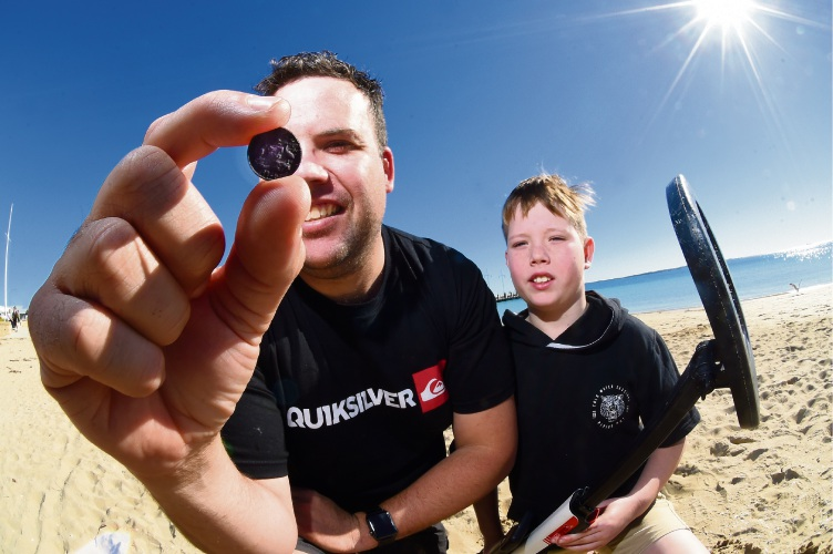 Aaron Trousselot with his son Kobe (9) enjoy coin hunting with metal detectors. Picture: Jon Hewson