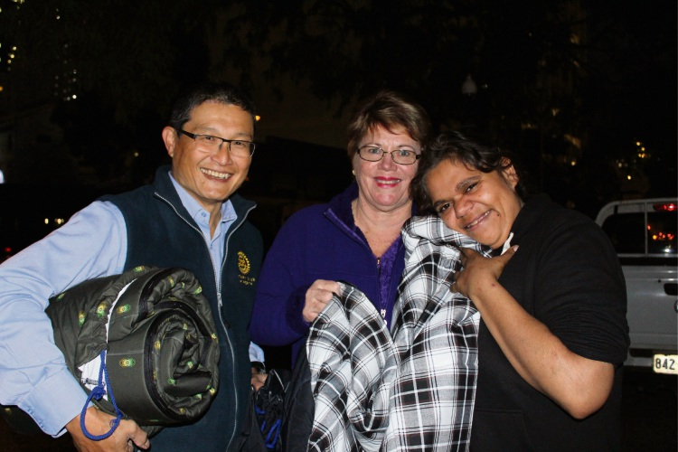 Perth Rotary President Wesley Sim, Stitches of Hope founder Kay Eva and Desiree.