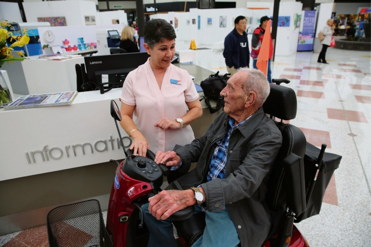 Ron Forrester gets a helping hand from Lakeside Joondalup Shopping City customer service officer Jenny Sloan.