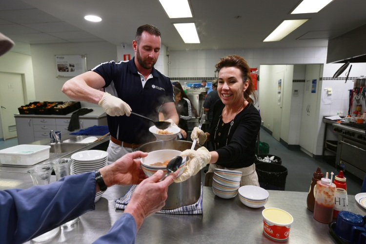 Daniel Cowley (MD Site Service Holdings) and Amanda Hunt (CEO Uniting Care West). Tranby Centre served kangaroo stew and damper followed by a screening of Noongar Footy Magic as part of Naidoc Week.  Picture: Andrew Ritchie.