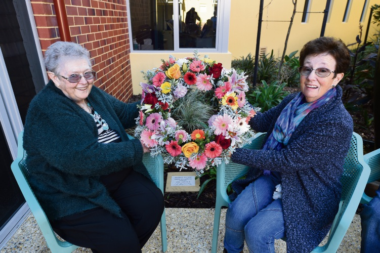 Kath McNeill, left, and Wendy Carlon with flowers donated by Jessons Flowers Canning Vale. Picture: Jon Hewson.