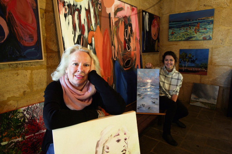 Trish Juniper and Jo Meredith with some of the artwork on display.