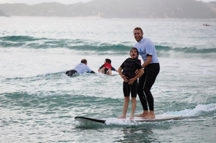 Jackson Shaw surfing with Meg Hithersay.