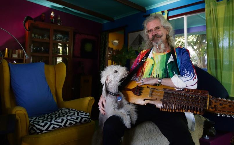 Digital artist Owen Bell (Quinns Rocks) with his dog Arrow. Photo: Martin Kennealey