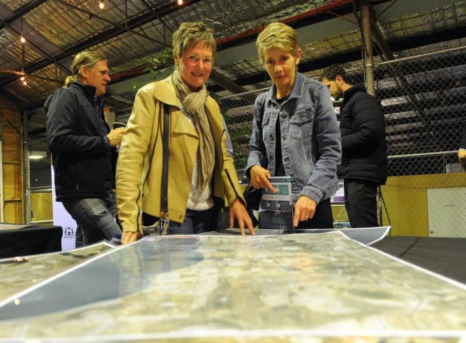 (l-r) North Fremantle's Susanna Bessell-Brown and Fremantle's Jane Hutchinson look at maps of the potential new port. Picture: Jon Bassett.