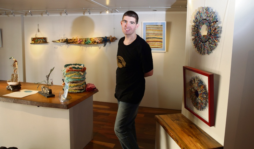 Josh Flintoff (Karrinyup) with his and Courtney's artwork (right). Courtney Smith was absent. Photo: Martin Kennealey