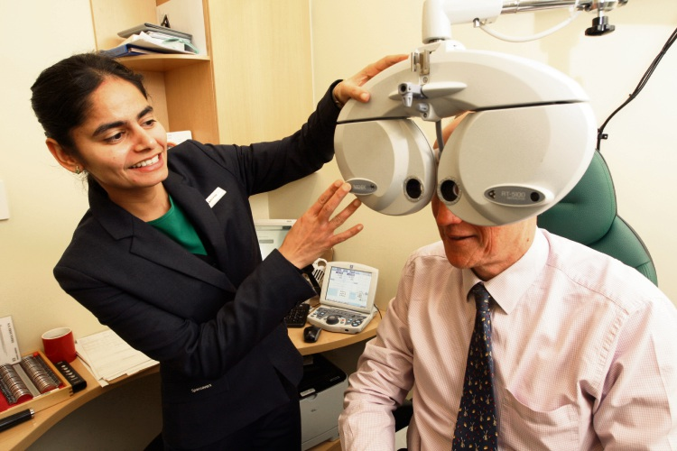 Optician Tanveer Kaur checks a client's eyesight. Picture: Bruce Hunt.