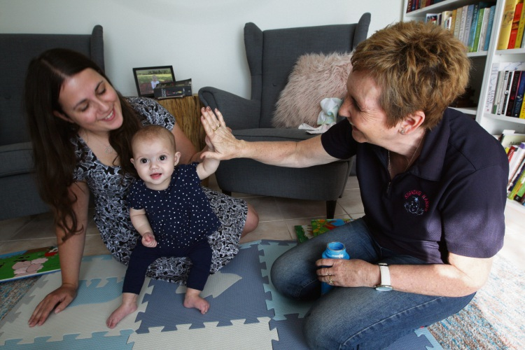Lucy Buchanan and her baby Esme with Signing Hands instructor Debbie Bundock. Picture: Bruce Hunt