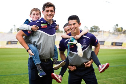 Fremantle Dockers' players Lloyd Meek and Bailey Banfield with Jake Worth and Rhianna Riley.