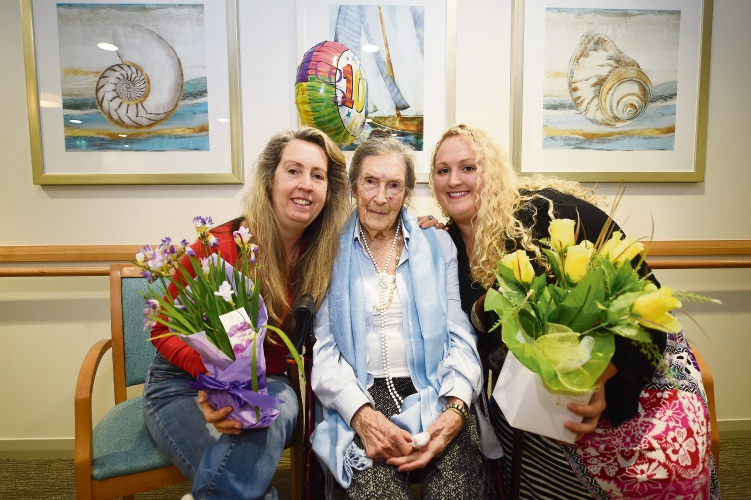 Kathleen Tredrea, centre, celebrates her 100th birthday with her daughter Jane Tredrea and her granddaughter Candice McDonald. Picture: Jon Hewson.
