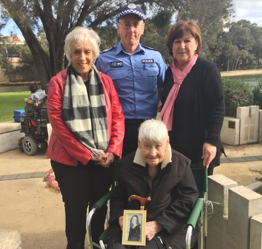 Peel Zonta members Margaret Wyatt and Deborah McLeod with Mandurah Officer in Charge Darren Hart and Jean Eaton with a photograph of her daughter at the Missing Persons Memorial.