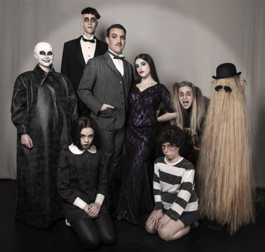 The cast of The Addams Family with Jayda D'Agostino (centre).