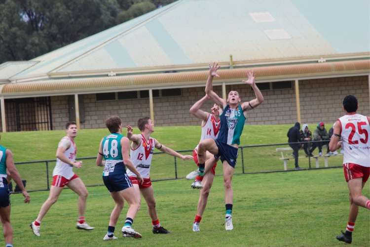 Peel Thunder player Luke Strnadica goes up for the mark.