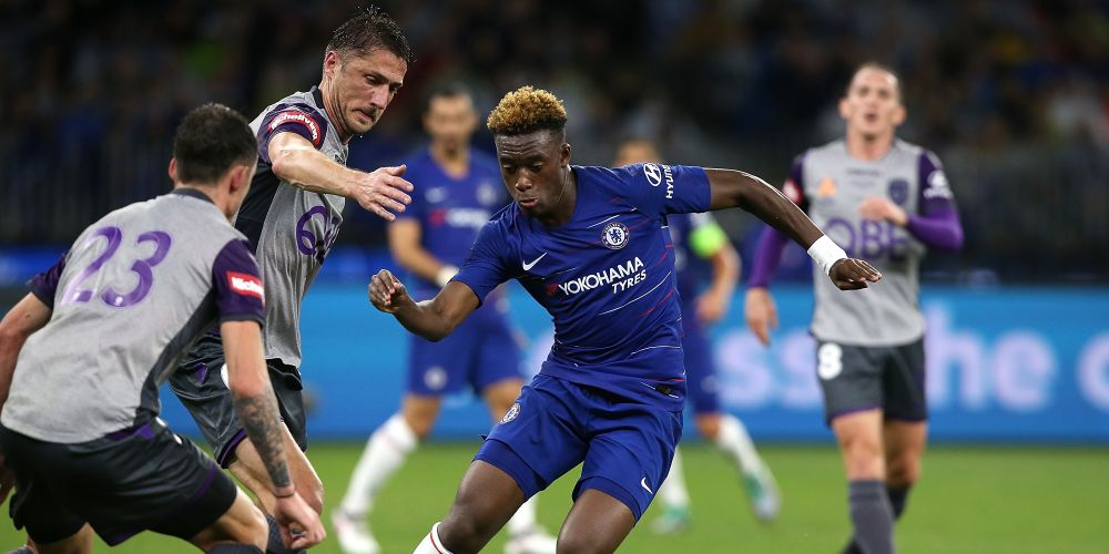 Callum Hudson-Odoi of Chelsea controls the ball against Dino Djulbic and Scott Neville of the Glory during the international friendly between Chelsea FC and Perth Glory at Optus Stadium on July 23, 2018 in Perth, Australia.  (Photo by Paul Kane/Getty Images)