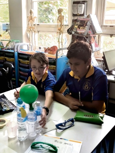 Belmont Primary School student Conner and Brett conducting their first experience in the new lab.