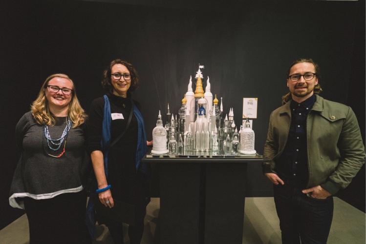 Mandorla Art Award judges Anne Ryan and Jarrod McKenna with Kalamunda artist Mikaela Castledine (centre) and her award-winning sculpture God is in the House.