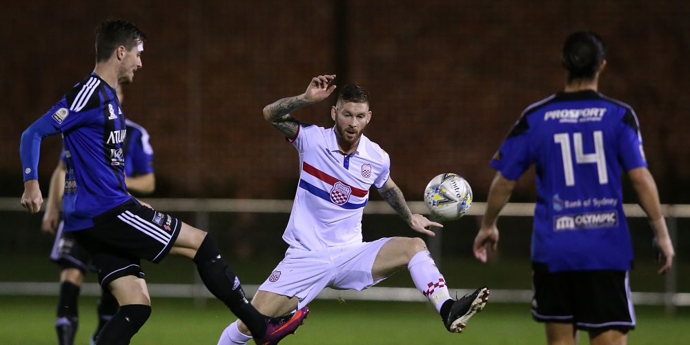 David Heagney of Gwelup Croatia attempts to block a pass by Allan Welsh of the Adelaide Comets during the FFA Cup round of 32 match between Gwelup Croatia and Adelaide Comets at Dorrien Gardens. Photo: Paul Kane/Getty Images
